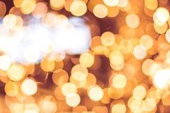 Fondo de Bokeh, lugar para el texto del día de fiesta Ligero borroso en fondo caliente del tono Almacene el concepto de la alamed fotografía de archivo libre de regalías