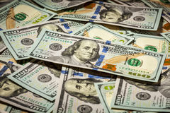 Fondo de cientos dólares de billetes de banco Imagenes de archivo