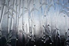 Fondo de cristal con el adorno de bambú de la planta Imagenes de archivo