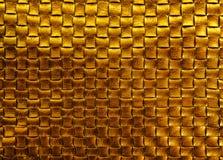 Fondo de cuero trenzado de bronce de la textura del oro Foto de archivo libre de regalías