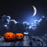 fondo de 3D Halloween con las calabazas y el cielo nocturno Foto de archivo libre de regalías