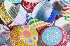 Fondo de empaquetado de papel de las magdalenas coloridas Foto de archivo libre de regalías