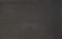 Fondo de goma rayado negro Foto de archivo