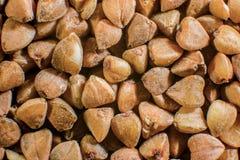 Fondo de granos de las avenas mondadas de alforfón Fotografía de archivo libre de regalías