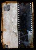 Fondo de Grunge con la tira de la película Foto de archivo libre de regalías
