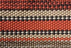 Fondo de la alfombra tejida Imagenes de archivo