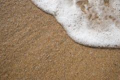 Fondo de la arena con la onda Fondo y onda hermosos franco de la arena Foto de archivo libre de regalías