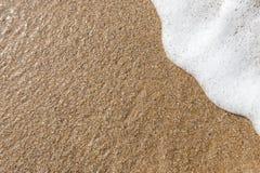 Fondo de la arena con la onda Fondo y onda hermosos franco de la arena Imagen de archivo