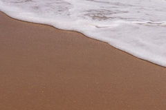 Fondo de la arena con la onda Fondo y onda hermosos franco de la arena Fotografía de archivo