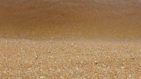 Fondo de la arena del impacto de la onda de agua del primer metrajes