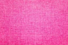Fondo de la arpillera coloreado en la mezcla del rosa y blanca foto de archivo