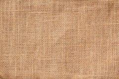 Fondo de la arpillera de la materia textil Fotografía de archivo