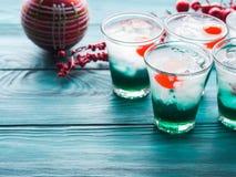 Fondo de la celebración de días festivos de la Navidad con las bebidas Fotografía de archivo