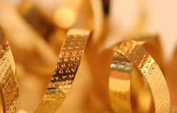 Fondo de la cinta del oro Foto de archivo libre de regalías