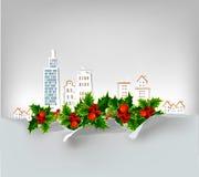 Fondo de la ciudad de la Navidad con el acebo hecho de las etiquetas engomadas de papel Imagen de archivo