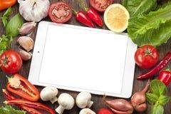 Fondo de la comida de las verduras de la tableta Foto de archivo libre de regalías