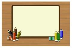 Fondo de la escuela con madera, los lápices y el lugar para el texto Foto de archivo libre de regalías