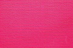 Fondo de la estera rosada de la yoga Imagenes de archivo