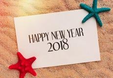 Fondo de la Feliz Año Nuevo con la estrella de mar Imagenes de archivo