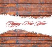 Fondo de la Feliz Año Nuevo con los copos de nieve y la textura de madera Imagen de archivo