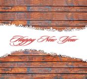 Fondo de la Feliz Año Nuevo con los copos de nieve y la textura de madera Fotografía de archivo