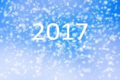 Fondo 2017 de la Feliz Año Nuevo de la tormenta borrosa de la nieve en el cielo azul Fotografía de archivo