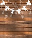Fondo de la Feliz Navidad con ángeles y juguetes Imagen de archivo libre de regalías