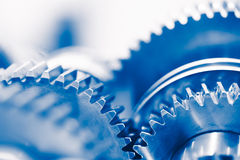 Fondo de la industria con las ruedas de engranaje azules Imágenes de archivo libres de regalías