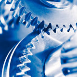 Fondo de la industria con las ruedas de engranaje azules Fotografía de archivo libre de regalías