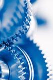Fondo de la industria con las ruedas de engranaje azules Fotos de archivo libres de regalías