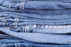 Fondo de la mezclilla azul Textura azul de los pantalones vaqueros del dril de algodón Fondo de los pantalones vaqueros Imagen de archivo libre de regalías
