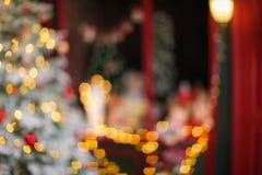 Fondo de la Navidad borrosa y del Año Nuevo con el bokeh Imagen de archivo libre de regalías