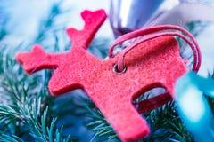 Fondo de la Navidad con el abeto y el reno Imagenes de archivo