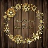 Fondo de la Navidad con el marco redondo de copos de nieve de oro y de l Imagen de archivo libre de regalías