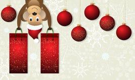 Fondo de la Navidad con el mono y las bolas rojas de la Navidad Fotografía de archivo libre de regalías