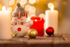 Fondo de la Navidad con el muñeco de nieve Foto de archivo libre de regalías