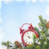 Fondo de la Navidad con el reloj y la rama Imagen de archivo