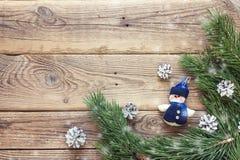 Fondo de la Navidad con la frontera de las ramas del abeto y de s miniatura Fotos de archivo