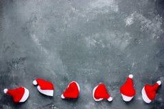 Fondo de la Navidad con la frontera del sombrero de santa Imagen de archivo libre de regalías