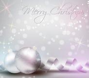 Fondo de la Navidad con las cintas y las chucherías brillantes de la Navidad Imagen de archivo libre de regalías