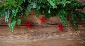 Fondo de la Navidad con las estrellas rojas Fotografía de archivo