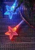 Fondo de la Navidad con las luces de la estrella imagen de archivo