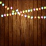 Fondo de la Navidad con las luces de la Navidad de madera Imagen de archivo