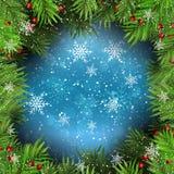 Fondo de la Navidad con las ramas de árbol de abeto en los copos de nieve Fotos de archivo libres de regalías