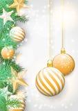 Fondo de la Navidad con las ramas verdes y los ornamentos amarillos Fotografía de archivo libre de regalías
