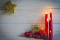 Fondo de la Navidad con las velas y un espacio para el texto Fotos de archivo libres de regalías