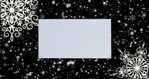Fondo de la Navidad con los copos de nieve en fondo negro Visión superior con el espacio de la letra y de la copia metrajes