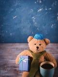 Fondo de la Navidad con un oso de peluche Fotografía de archivo