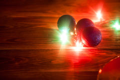 Fondo de la Navidad de la foto con las luces del color Imagen de archivo libre de regalías