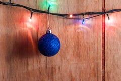Fondo de la Navidad de la foto con las luces del color Imagenes de archivo